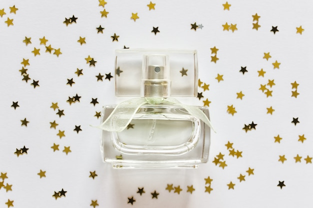 Bottle of fragrance perfume on with stars