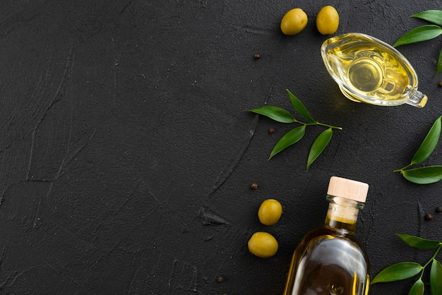 Bottle and glass of olive oil with copy space