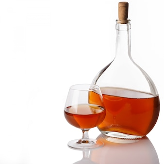 Bottle and glass with cognac