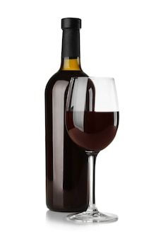 Bottle and glass with red wine on white
