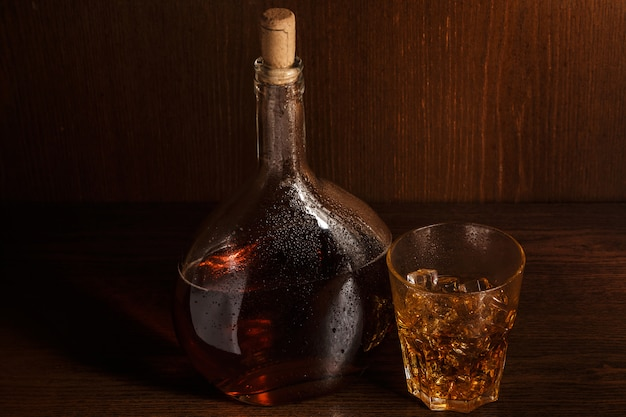 Bottle and glass with whisky