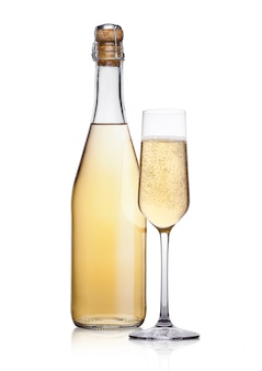Bottle and glass of yellow champagne with bubbles on white background with reflection