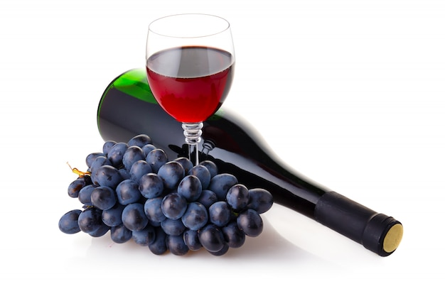 Bottle and goblet of red wine with branch of grapes isolated