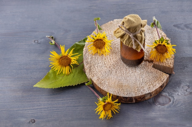 A bottle of homemade tincture of elecampane and flowers