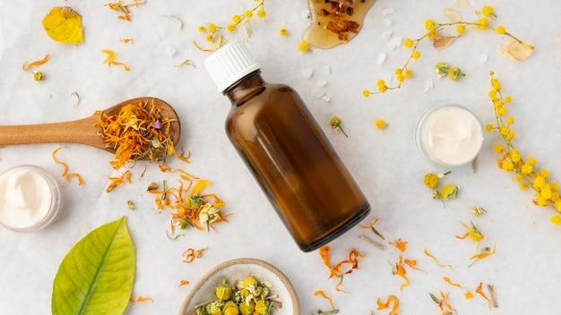 Bottle and ingredients arrangement top view