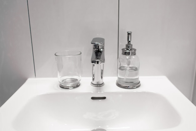 A bottle of liquid soap on the washstand