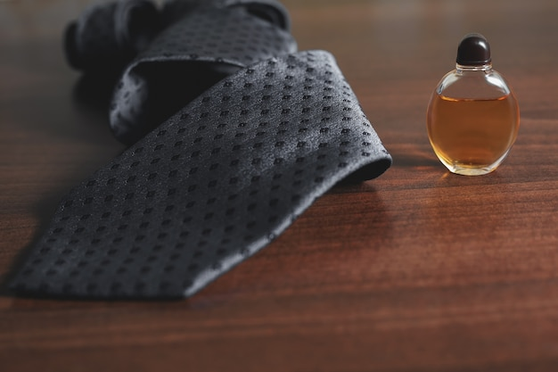 Bottle of men's perfume with tie