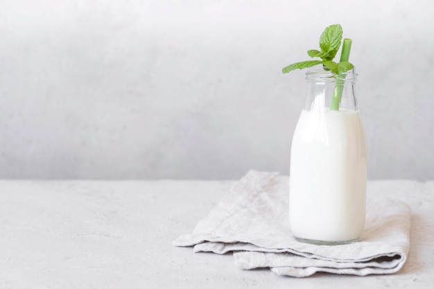 Bottle of milk and peppermint leaves