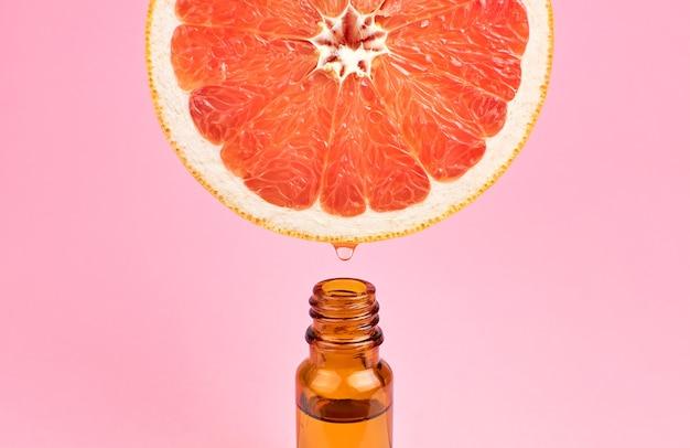 Бутылка эфирного масла цитрусовых