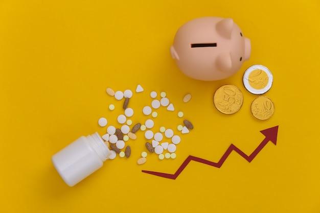 노란색에 동전과 돼지 저금통을 돌보는 화살표와 약의 병