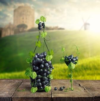 ワインのボトルとブドウの葉とブドウの房で作られたグラス