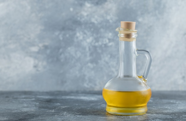 Bottle of oil on the grey background. high quality photo