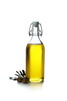 Bottle of olive oil and olives isolated on white
