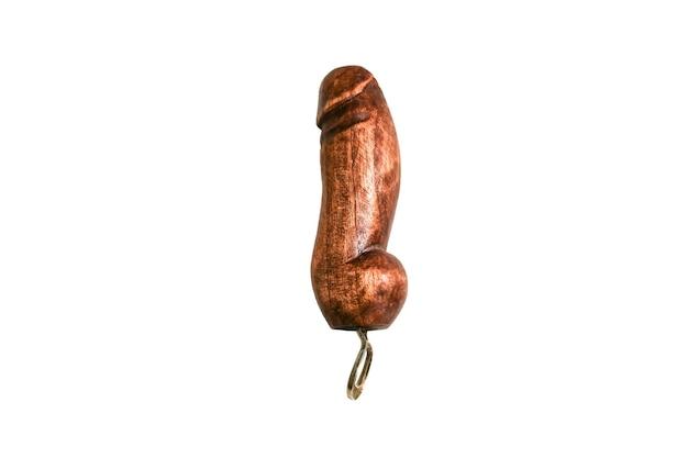 白い背景で隔離の木製の陰茎の形で栓抜き。国からのお土産。