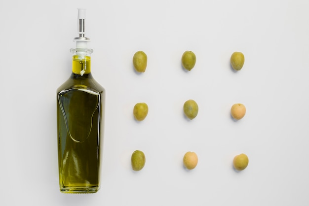 Bottle of organic olive oil and olives
