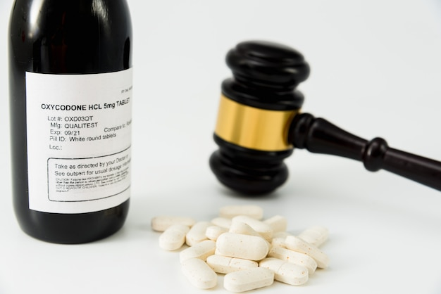 Bottle of oxycodone obtained illegally, concept of medical false prescriptions.