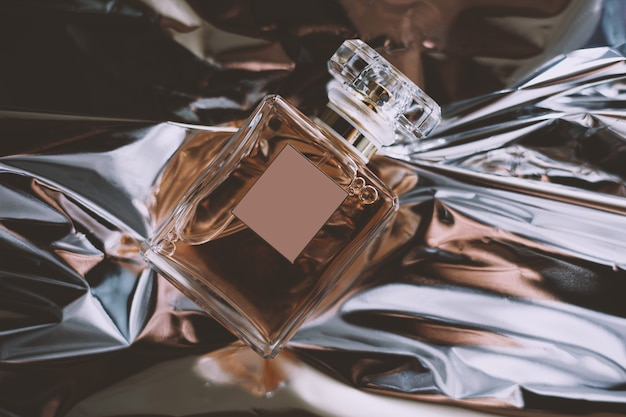 Bottle of perfume on a shiny background