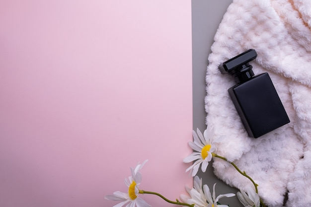 Bottle of perfume on a towel