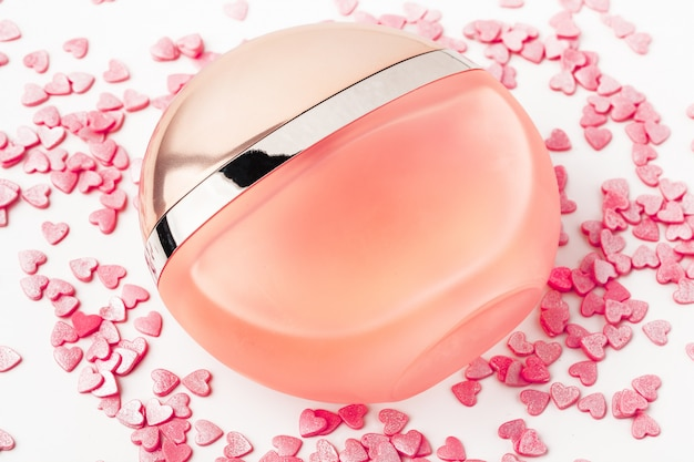 Bottle of perfume with red hearts