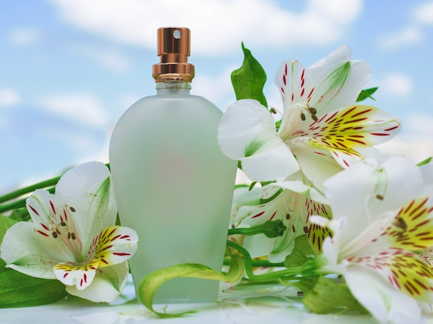 Bottle of perfume with white orchid