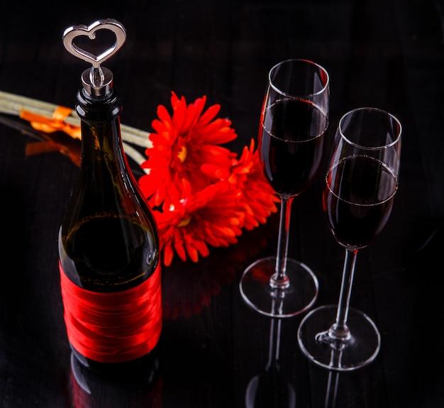 Bottle of red wine, glasses