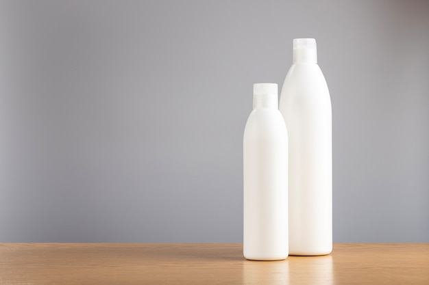 Bottle of shampoo and hair conditioner on a gray background. detergents for hair care.