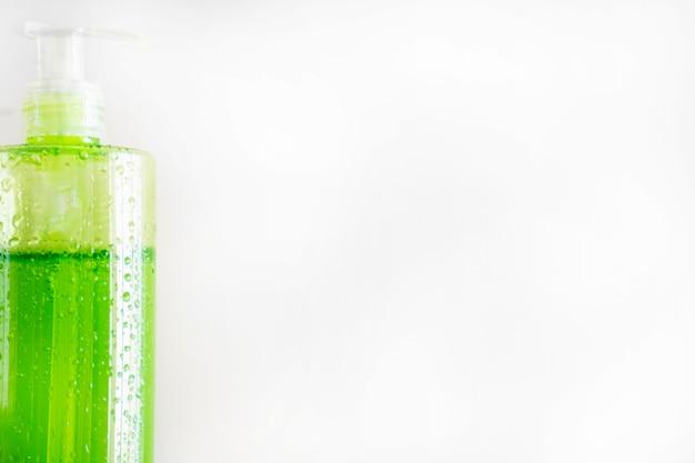 Bottle of skincare product on white background