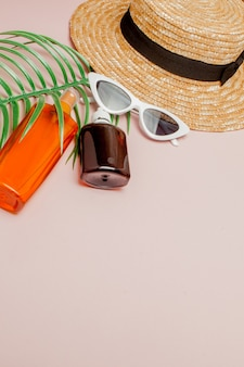 Bottle sunblock on bright square yellow and pink background. concept of the resort at sea, summer time.