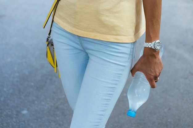 Bottle of water in a female hand closeup