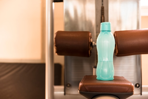 Bottle of water on gym tool