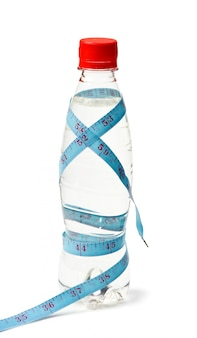Bottle water weight loss isolated on a white surface