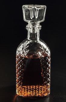 Bottle of whiskey, or rum, or alcohol stands