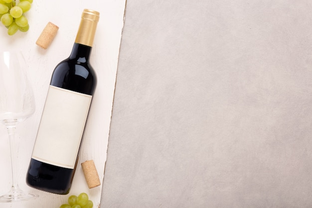 Bottle of white wine with label. glass of wine and cork. wine bottle mockup.