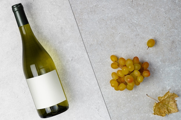 Bottle of white wine with label.  wine and grape. wine bottle mockup. top view.