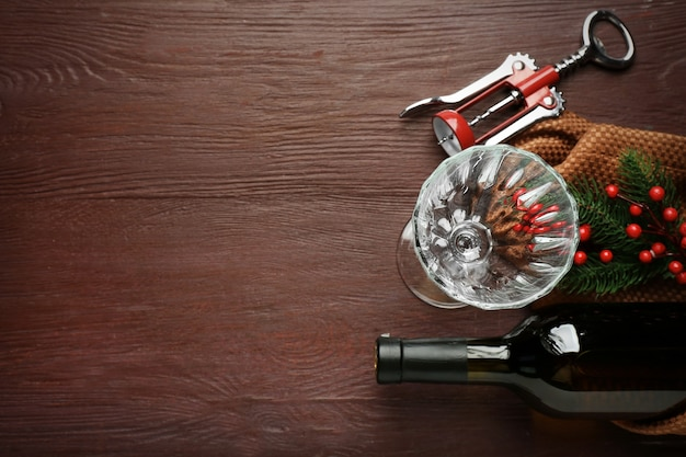 Bottle of wine and empty glass on wooden table