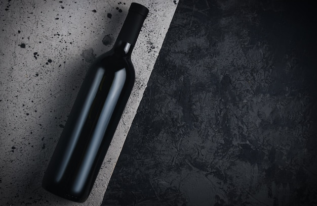Bottle of wine on grey concrete background copy space