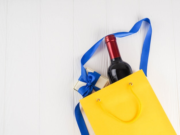 Bottle of wine in the package with a gift, top view