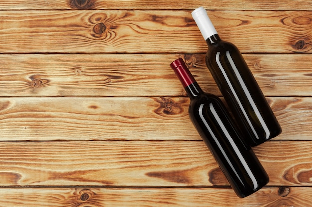 Bottle of wine over wooden background
