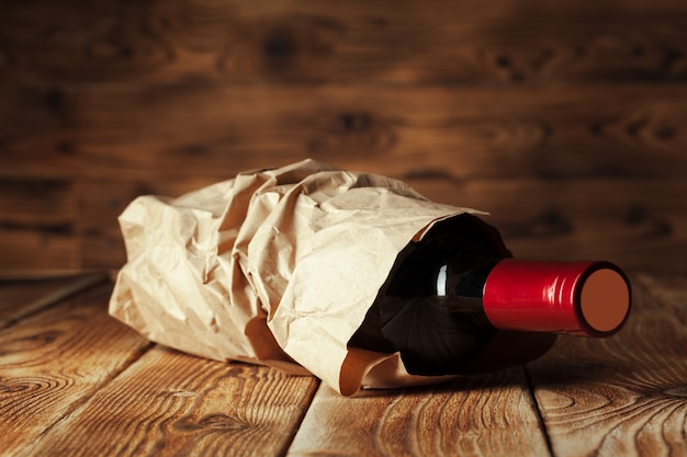 Bottle of wine over wooden table