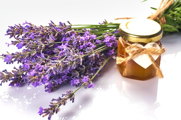Bottle with aroma oil and lavender flowers