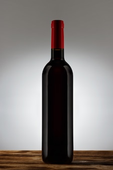 Bottle with red wine with a light gradient on the background