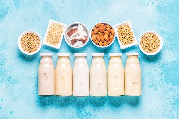 A bottles of alternative  milk and ingredients, top view.