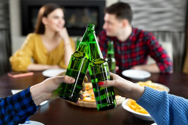Bottles of beer.group of friends enjoying party.people are drinking beer and laughing .