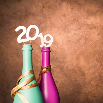 Bottles of beverage with 2019 numbers on wands