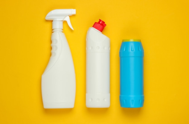 Bottles for cleaning on yellow background. top view. minimalism