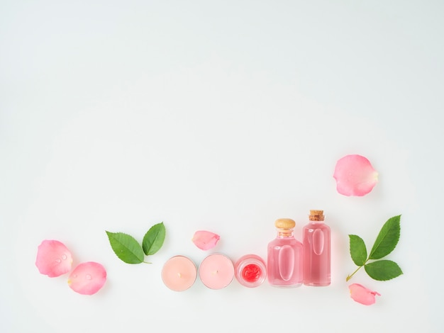 Bottles of essential oil and roses