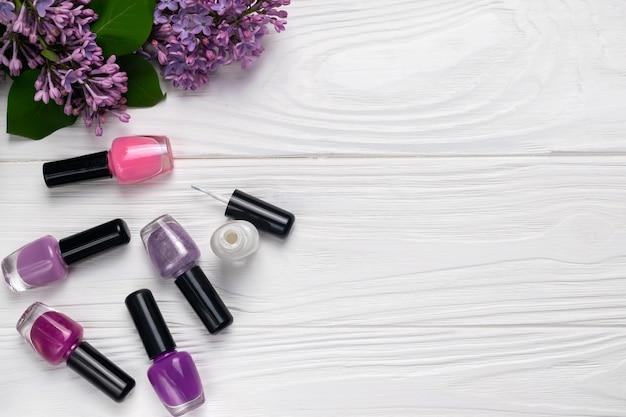 Bottles of nail polish on white background