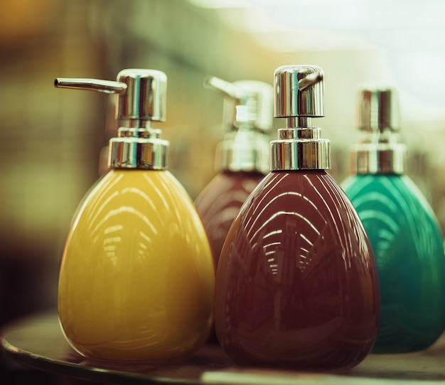Bottles for soap in the store, soft tones