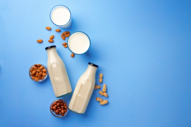 Bottles of vegan non dairy milk with various nuts
