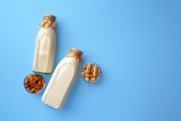 Bottles of vegan nondairy milk with various nuts